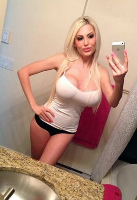 Blonde bimbo selfshot her big hot amateur boobs
