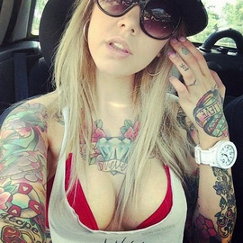 The whole body of the blonde is covered with tattoos