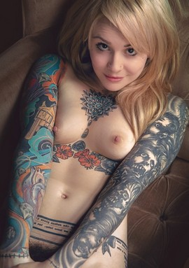 Photo of tattooed slutty blonde.