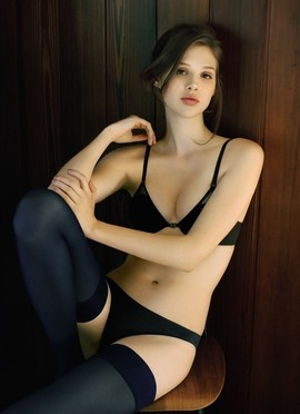 Babe in black lingerie and thigh highs.